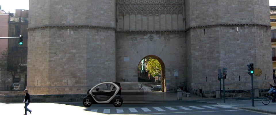FIguración del modelo más pequeño de Hellobyecars pasando junto a las Torres de Serranos. Fotomontaje: Javier Furió