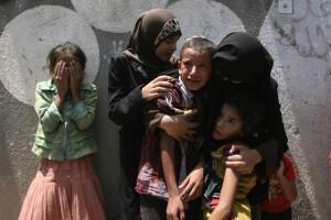 Niños palestinos durante un funeral en Rafah, en el sur de la Franga de Gaza Foto UNICEF/ElBaba