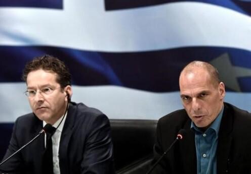 El presidente del Eurogrupo, Jeroen Dijsselbloem junto al ministro de Finanzas griego, Yanis Varoufakis. (Foto-AFP)