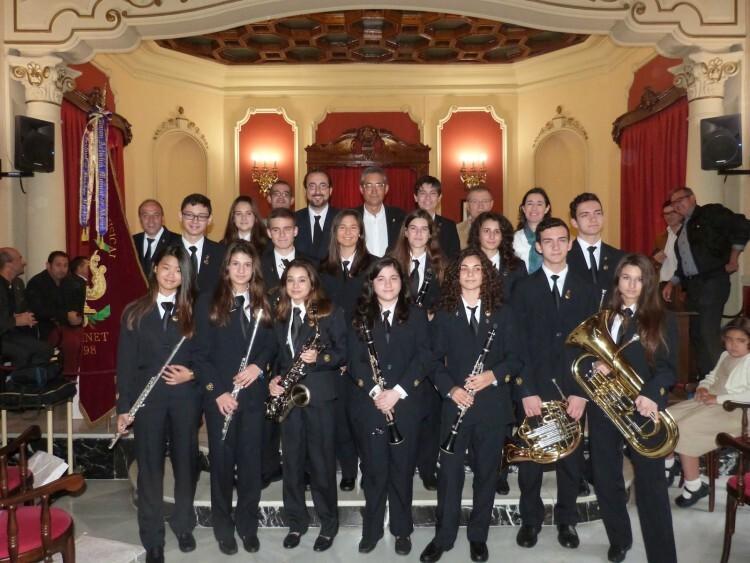Nous_membres_de_la_Banda_de_la   Societat Artística musical d' class=