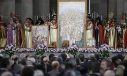 Priests attend a canonisation ceremony for the victims of mass killings of Armenians by Ottoman Turks at the open-air altar of Armenia's main cathedral in Echmiadzin April 23, 2015.Armenia's president said on Wednesday he was ready to normalize relations with Turkey, two months after he withdrew peace accords from parliament, blaming a Turkish lack of political will to end 100 years of hostility. REUTERS/David Mdzinarishvili