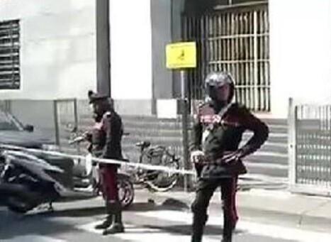La policía italiana vigila el Palacio de Justicia de MIlán en una imagen tomada de la televisión pública italiana.