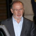 Former People's Party minister and former IMF managing director Rato leaves his office after an inspection in Madrid