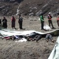 ATTENTION EDITORS - VISUAL COVERAGE OF SCENES OF INJURY OR DEATH  Recovered bodies are lined up after a massive avalanche triggered by last week's earthquake overwhelmed Langtang village, Nepal, in this May 2, 2015 police handout photo. About 100 bodies were recovered on Saturday and Sunday at Langtang village, 60 km (37 miles) north of Kathmandu, which is on a trekking route popular with Westerners. The entire village, which includes 55 guesthouses for trekkers, was wiped out by the avalanche and rescuers are digging in the snow for signs of about 120 others believed buried. REUTERS/Handout via Reuters TPX IMAGES OF THE DAY  ATTENTION EDITORS - NO SALES. NO ARCHIVES. FOR EDITORIAL USE ONLY. NOT FOR SALE FOR MARKETING OR ADVERTISING CAMPAIGNS. THIS PICTURE WAS PROVIDED BY A THIRD PARTY. REUTERS IS UNABLE TO INDEPENDENTLY VERIFY THE AUTHENTICITY, CONTENT, LOCATION OR DATE OF THIS IMAGE. THIS PICTURE IS DISTRIBUTED EXACTLY AS RECEIVED BY REUTERS, AS A SERVICE TO CLIENTS. TEMPLATE OUT