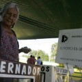 A woman casts her vote during local elections in village San Agustin Etla, state of Oaxaca