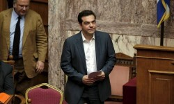 Greek Prime Minister Alexis Tsipras arrives for a parliamentary session in Athens, Greece July 16, 2015. The Greek parliament passed a sweeping package of austerity measures demanded by European partners as the price for opening talks on a multi-billion euro bailout package needed to keep the near-bankrupt country in the euro zone. REUTERS/Alkis Konstantinidis