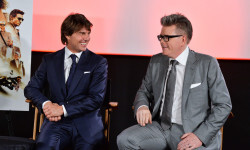Actor Tom Cruise and director Christopher McQuarrie attend the Canadian Fan Premiere of 'Mission: Impossible – Rogue Nation' at the Cineplex Scotiabank Theatre on July 27, 2015 in Toronto, Canada. (Photo by George Pimentel/Getty Images for Paramount Pictures International)