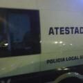 Vehículo de Atestados de la Policía en el lugar de los hechos.