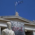 The word 'No' in Greek is seen on a banner hanging from Athens' University building in Athens, Greece, July 2, 2015. Prime Minister Alexis Tsipras called on Greeks to vote 'no' in Sunday's referendum on a bailout package offered by creditors, in a defiant address that dispelled speculation he was rowing back on the plan under mounting pressure. REUTERS/Marko DjuricaCODE: X01390