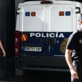 A Spanish police van transporting convicted child rapist Spaniard Daniel Galvan arrives to a courthouse for his appearance before a judge who will decide if he returns to jail in Madrid on August 6, 2013.  Galvan, found guilty of raping 11 children aged between four and 15 in Morocco and sentenced in September 2011 to 30 years in prison there, was arrested yesterday at a hotel in the southeastern city of Murcia after mistakenly being pardoned by Morocco's King Mohamed VI. Morocco is seeking the extradition of the 63-year-old who was among 48 Spanish prisoners pardoned by the Moroccan King and freed last week from jail following a visit in mid-July to Morocco by Spain's King Juan Carlos.  AFP PHOTO / DOMINIQUE FAGET