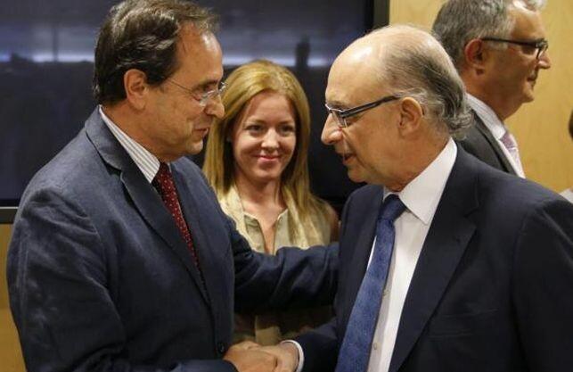 Vicent Soler y Cristóbal Montoro, ministro de Hacienda, en el Consejo de Política Fiscal y Financiera.