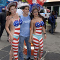 SIRENS OF THE SQUARE  -  Times Square A seventeen year taking photo with topless painted Times Sq females