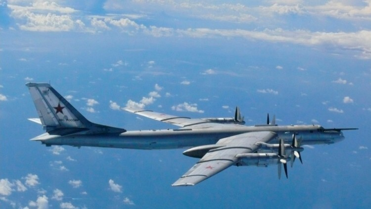 A Russian TU-95 bomber flies through airspace northwest of Okinoshima island, Fukuoka prefecture in the southern island of Kyushu, in this handout picture taken by Japan Air Self-Defence Force and released by the Defense Ministry of Japan August 22, 2013. Two Russian bombers entered Japan's airspace near its southern major island of Kyushu on Thursday, prompting Japan's military to scramble its fighter jets and lodge a protest against the Russian government, the Japanese defence and foreign ministries said.    REUTERS/Defense Ministry of Japan/Handout via Reuters (JAPAN - Tags: MILITARY POLITICS) ATTENTION EDITORS - THIS IMAGE HAS BEEN SUPPLIED BY A THIRD PARTY. FOR EDITORIAL USE ONLY. NOT FOR SALE FOR MARKETING OR ADVERTISING CAMPAIGNS. IT IS DISTRIBUTED, EXACTLY AS RECEIVED BY REUTERS, AS A SERVICE TO CLIENTS - RTX12T3Z