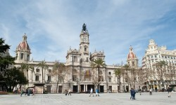 People walking in Ajuntament square. Valencia, Spain.