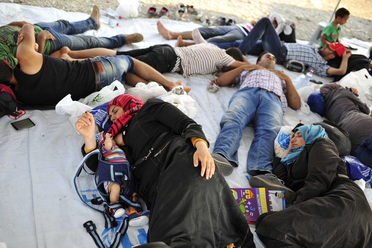 On 26 August, children, women and men rest atop a tarpaulin near the town of Gevgelija, on the border with Greece. In late August 2015 in the former Yugoslav Republic of Macedonia, more than 52,000 people have been registered at the border by police in the town of Gevgelija, after entering from Greece, since June 2015. Since July 2015, the rate of refugees and migrants transiting through the country has increased to approximately 2,000 to 3000 people per day. Women and children now account for nearly one third of arrivals. An estimated 12 per cent of the women are pregnant. Many are escaping conflict and insecurity in their home countries of Afghanistan, Iraq, Pakistan and the Syrian Arab Republic. There are children of all ages traveling with their families. Some are unaccompanied minors aged 16–18 years who are traveling in groups with friends. They are arriving in the country from Greece, transiting to Serbia and further to Hungary, from where they generally aim to reach other countries in the European Union.