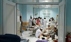 """TOPSHOTS In this undated photograph released by Medecins Sans Frontieres (MSF) on October 3, 2015, Afghan MSF medical personnel treat civilians injured following an offensive against Taliban militants by Afghan and coalition forces at the MSF hospital in Kunduz. An air strike on the hospital in the Afghan city of Kunduz on October 3 left three Doctors Without Borders staff dead and dozens more unaccounted for, the medical charity said, with NATO conceding US forces may have been behind the bombing. The MSF facility is seen as a key medical lifeline in the region and has been running """"beyond capacity"""" during recent fighting that saw the Taliban seize control of the provincial capital for several days. AFP PHOTO / MSF ----EDITORS NOTE---- RESTRICTED TO EDITORIAL USE - MANDATORY CREDIT """"AFP PHOTO/MSF"""" - NO MARKETING NO ADVERTISING CAMPAIGNS - DISTRIBUTED AS A SERVICE TO CLIENTS -----"""