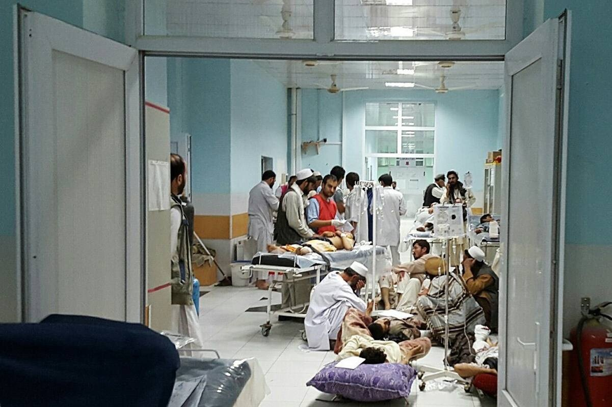 "TOPSHOTS In this undated photograph released by Medecins Sans Frontieres (MSF) on October 3, 2015, Afghan MSF medical personnel treat civilians injured following an offensive against Taliban militants by Afghan and coalition forces at the MSF hospital in Kunduz. An air strike on the hospital in the Afghan city of Kunduz on October 3 left three Doctors Without Borders staff dead and dozens more unaccounted for, the medical charity said, with NATO conceding US forces may have been behind the bombing. The MSF facility is seen as a key medical lifeline in the region and has been running ""beyond capacity"" during recent fighting that saw the Taliban seize control of the provincial capital for several days. AFP PHOTO / MSF ----EDITORS NOTE---- RESTRICTED TO EDITORIAL USE - MANDATORY CREDIT ""AFP PHOTO/MSF"" - NO MARKETING NO ADVERTISING CAMPAIGNS - DISTRIBUTED AS A SERVICE TO CLIENTS -----"