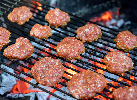 Grilled burgers on a barbecue grill close-up