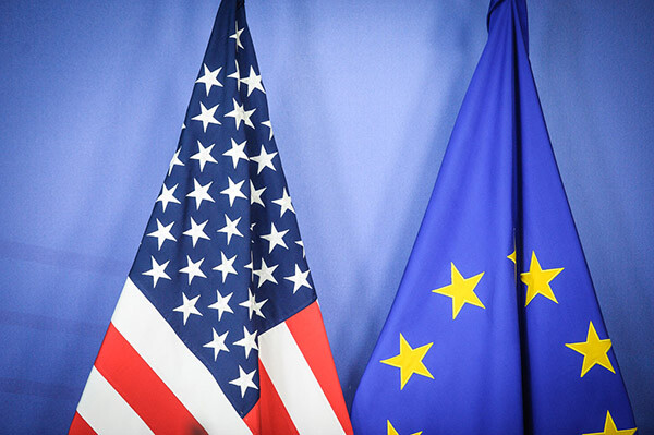Jan. 26, 2015 - Brussels, Bxl, Belgium - US and EU flags seen during Treasury Secretary Jack Lew a press conference after a meeting at EU Commission headquarters in Brussels, Belgium on 26.01.2015 Lew said the US economy still needs pushing to continue growth, and that US alone could not lead global economic recovery. Reports also state Lew said Greece is moving on to solve their problems after having to make tough decisions. In the meantime, European financial markets on Monday shrugged off the news that the anti-austerity SYRIZA party had emerged as the victor in Greece' class=