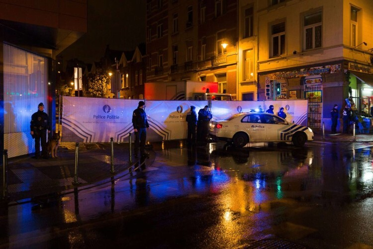 "Belgian police cordon off a street during a police raid in connection with the November 13 deadly attacks in Paris, in Brussels' Molenbeek district on November 14, 2015. Several people were arrested in Brussels on November 14 during police raids connected to the attacks in Paris, Belgian Justice Minister Koen Geens said. Geens said on RTBF television that these arrests in the capital's Molenbeek neighbourhood ""can be seen in connection with a grey Polo car rented in Belgium"" found near the concert hall in the French capital where scores of people were killed.    AFP PHOTO / BELGA / JAMES ARTHUR GEKIERE = BELGIUM OUT ="