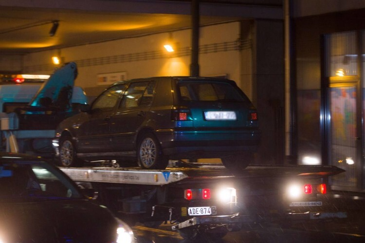 "A car is towed during a police raid in Brussels' Molenbeek district on November 14, 2015, in connection with the November 13 deadly attacks in Paris. Several people were arrested in Brussels on November 14 during police raids connected to the attacks in Paris, Belgian Justice Minister Koen Geens said. Geens said on RTBF television that these arrests in the capital's Molenbeek neighbourhood ""can be seen in connection with a grey Polo car rented in Belgium"" found near the concert hall in the French capital where scores of people were killed. AFP PHOTO / BELGA / JAMES ARTHUR GEKIERE = BELGIUM OUT ="