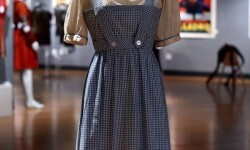 "A Judy Garland-worn ""Dorothy"" dress from The Wizard of Oz is displayed during a press preview on November 19, 2015 in New York, as Bonhams And Turner Classic Movies (TCM)  Present ""Treasures from the Dream Factory""  auction to take place  November 23 in New York . AFP PHOTO / TIMOTHY A. CLARY"
