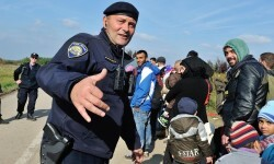 Zoran Markovic, 45 years old, police commander, in charge of a team  responsible for teh transfer of refugees and migrants onto buses for transport to Opatovic Transit Center soon after they have crossed the chaotic border from Serbia at Bapska. He  was himself previously a refugee during the war in the Balkans which heavily effected this region.  ' If something like that happens to you, you can never forget it .... I feel that I am here to help these people who flee today. They all have the same problem, no matter if they come from Syria, Iraq or Afghanistan. They flee the war. Most of them don't know where they will end up'