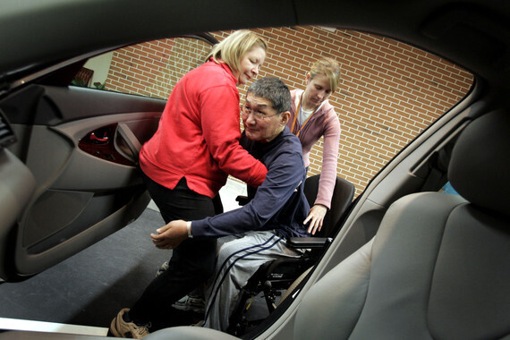 Dec 22, 2006; Toronto, ON, Canada; BRIAN IMADA, who has Guillain-Barre Syndrome, (an auto-immune disease that attacks nerves) practices getting from his wheelchair into a car with his wife Sandy.(Credit Image:  Peter Power/Toronto Star/ZUMAPRESS.com)
