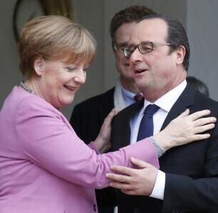 Francois Hollande y Angela Merkel.