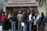 People line up to enter a government job centre in Madrid