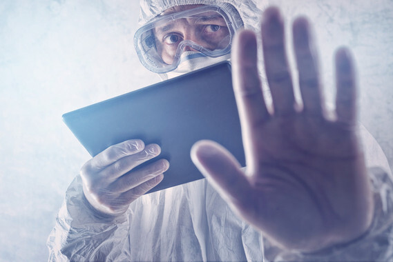 Medical Scientist Reading Internet Pages About MERS Virus on Figital Tablet Computer