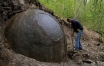 Suad Keserovic cleans a stone ball in Podubravlje village near Zavidovici  Bosnia and Herzegovina April 11  2016  Keserovic claimed that the stone sphere is 3 30 meter in diameter and the estimated weight of it is about 35 tons  Hundreds of tourists from around the world have visited this stone  REUTERS Dado Ruvic