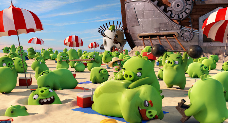 The pigs enjoying the beach in Columbia Pictures and Rovio Animation' class=