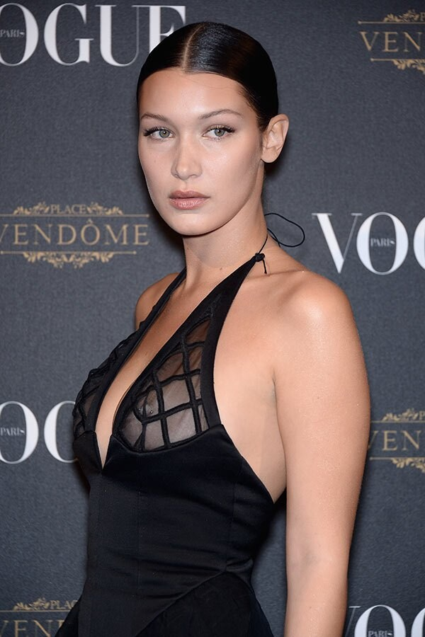 bella-hadid-flashes-nipple-ring-ftr