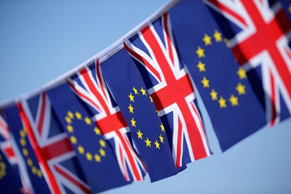In this photo illustration the European Union and the Union flag sit together on bunting on March 17, 2016 in Knutsford, United Kingdom. The United Kingdom  will hold a referendum on June 23, 2016 to decide whether or not to remain a member of the European Union (EU), an economic and political partnership involving 28 European countries which allows members to trade together in a single market and free movement across it's borders for cirtizens.