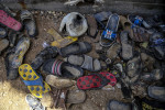 Shoes left behind by victims of a suicide bombing of Al-Shuhadaa Stadium in the city of  Iskandariya, Babil Governorate. On March 25, 2016 a suicide bomber detonated an explosive belt at 6:15 PM as a crowd gathered here for an award ceremony after a football game at the stadium.   According to media reports, 43 people died and more than 100 were injured in the bombing. Of those who died, 29 were boys younger than 17 who had been participating in the match or watching their friends play. The bombing was claimed by ISIL. Local officials and media reports claim that the suicide bomber was a boy no older than 16.