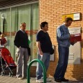 People line up to enter a government job center in Madrid, Friday, May 28, 2010. INEM