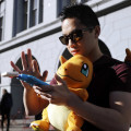 "Tim C., who did not want to give his last name, searches for Pokemon during a gathering of ""Pokemon Go"" players Wednesday, July 20, 2016, in San Francisco.(AP Photo/Marcio Jose Sanchez)"