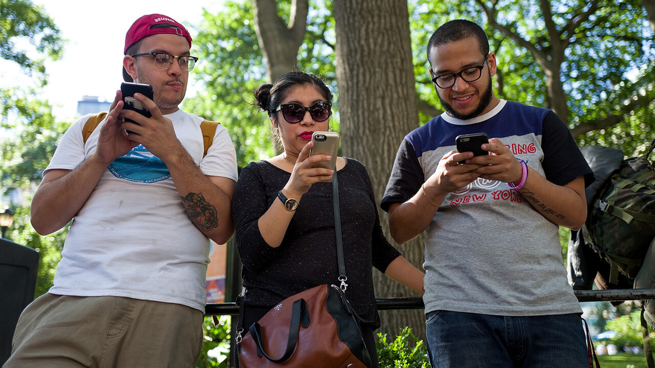 NEW YORK, NY - JULY 11: A group of friends play Pokemon Go on their smartphones at Union Square, July 11, 2016 in New York City. The success of Nintendo' class=