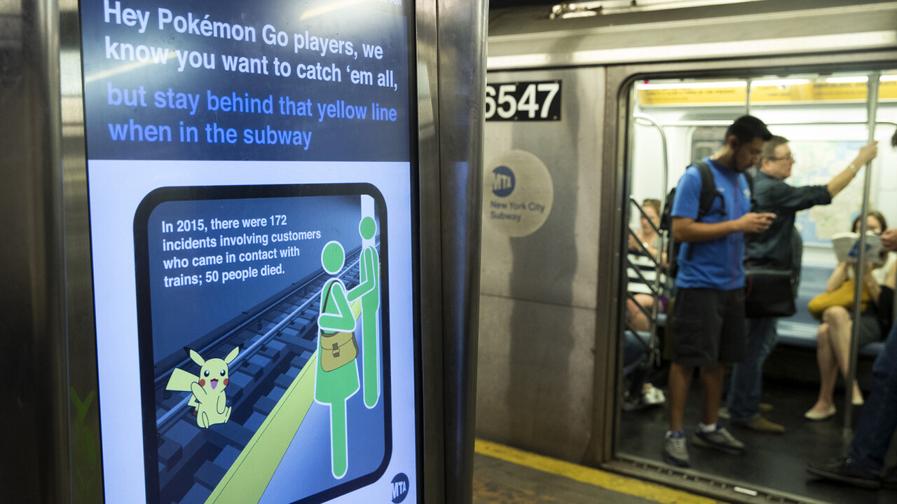 NEW YORK, NY - JULY 20: A safety message is displayed on a screen in the 14th Street subway station, July 20, 2016 in New York City. The Metropolitan Transportation Authority (MTA) has placed digital signage in subway stations encouraging riders to be safe while playing the Pokemon Go app on their smartphones. Drew Angerer/Getty Images/AFP