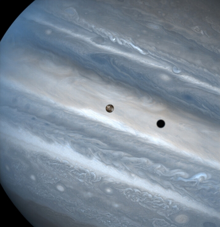The three snapshots of the volcanic moon rounding Jupiter were taken over a 1.8-hour time span. Io is roughly the size of Earth' class=
