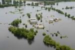 This June 13, 2015, aerial photo shows flooding of the Red River in Alexandria, La. The Red River is still falling slowly at Shreveport and wasn't expected to begin falling near Natchitoches until late Sunday, so it will be a while before northwest Louisiana business owners know the full extent of flood damage. (Melinda Martinez/The Daily Town Talk via AP)  NO SALES