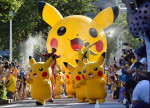 Performers dressed as Pikachu, the popular animation Pokemon series character, perform in the Pikachu parade in Yokohama on August 7, 2016. Some 50 life-size Pikachu characters, the most famous from the Pokemon game, marched along the city's waterfront street as visitors took mobile phone pictures and videos of them in scorching sunshine. / AFP PHOTO / KAZUHIRO NOGI