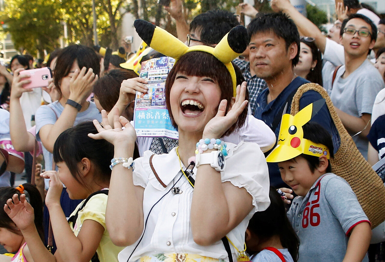 People react as performers splash water during a Pokemon parade in Yokohama, Japan, August 7, 2016. REUTERS/Kim Kyung-Hoon