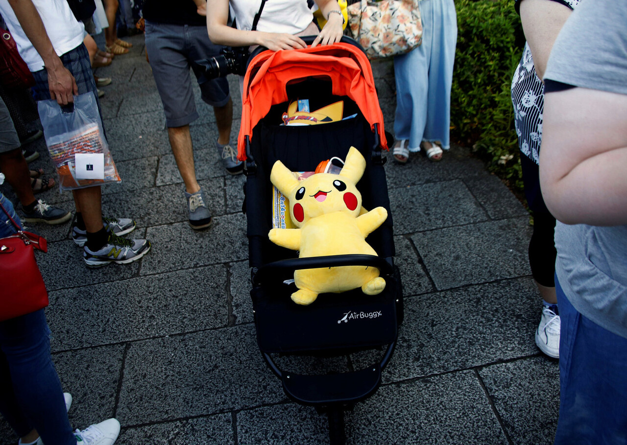 A woman pushes a baby stroller with a Pokemon character Pikachu doll in Yokohama, Japan, August 7, 2016. REUTERS/Kim Kyung-Hoon FOR EDITORIAL USE ONLY. NO RESALES. NO ARCHIVES.