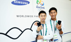 RIO DE JANEIRO, NEW ZEALAND - AUGUST 03:  Byun Young Jun (L) and Byeong Kwang Choe of Korea visit the Samsung Galaxy Studio in the 2016 Olympic Village on August 3, 2016 in Rio de Janiero, Brazil.  (Photo by Hagen Hopkins/Getty Images) *** Local Caption *** Kayla Harrison
