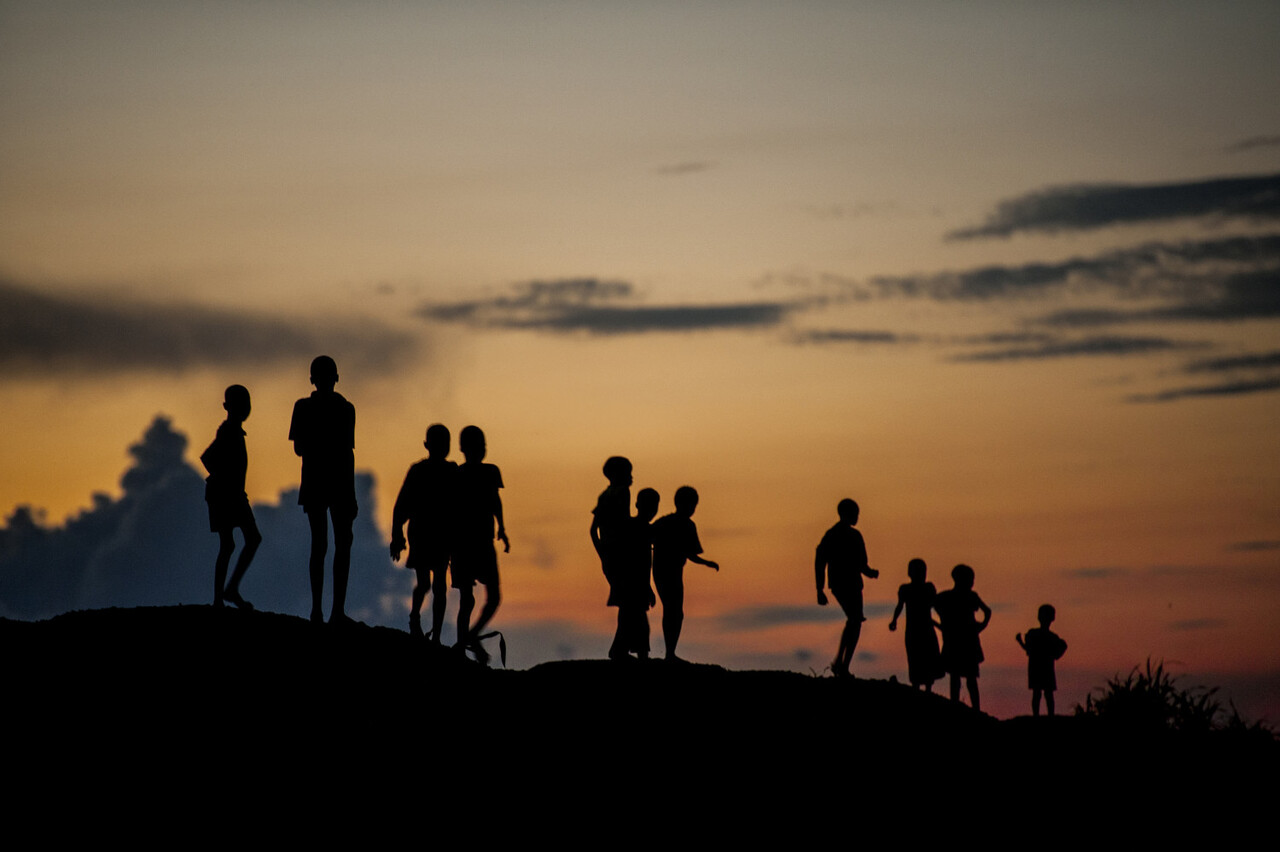 "On 14 August 2016 in the Protection of Civilians (POC) site near Bentiu, in Unity State, South Sudan, children play at dusk. Since the beginning of 2016, more than 650 children have been recruited into armed groups in South Sudan.  Fearful that renewed conflict could put tens of thousands of children at ever greater risk, UNICEF called for an immediate end to recruitment and the unconditional release of all children by armed actors.  An estimated 16,000 children have been recruited by armed groups and armed forces since the crisis in South Sudan first began in December 2013. UNICEF said children continue to be recruited and used by armed groups and forces despite widespread political commitment to end the practice.  ""The dream we all shared for the children of this young country has become a nightmare,"" said UNICEF Deputy Executive Director Justin Forsyth, upon his return from Bentiu and Juba in South Sudan. ""At this precarious stage in South Sudan's short history, UNICEF fears that a further spike in child recruitment could be imminent.""  In 2015, UNICEF oversaw the release of 1,775 former child soldiers in what was one of the largest demobilizations of children ever. Renewed fighting and recruitment in South Sudan risks undermining much of this progress."