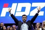 Andrej Plenkovic, president of Croatian Democratic Union (HDZ), waves to his supporters during an election rally in Zagreb, Croatia, September 8, 2016. REUTERS/Antonio Bronic