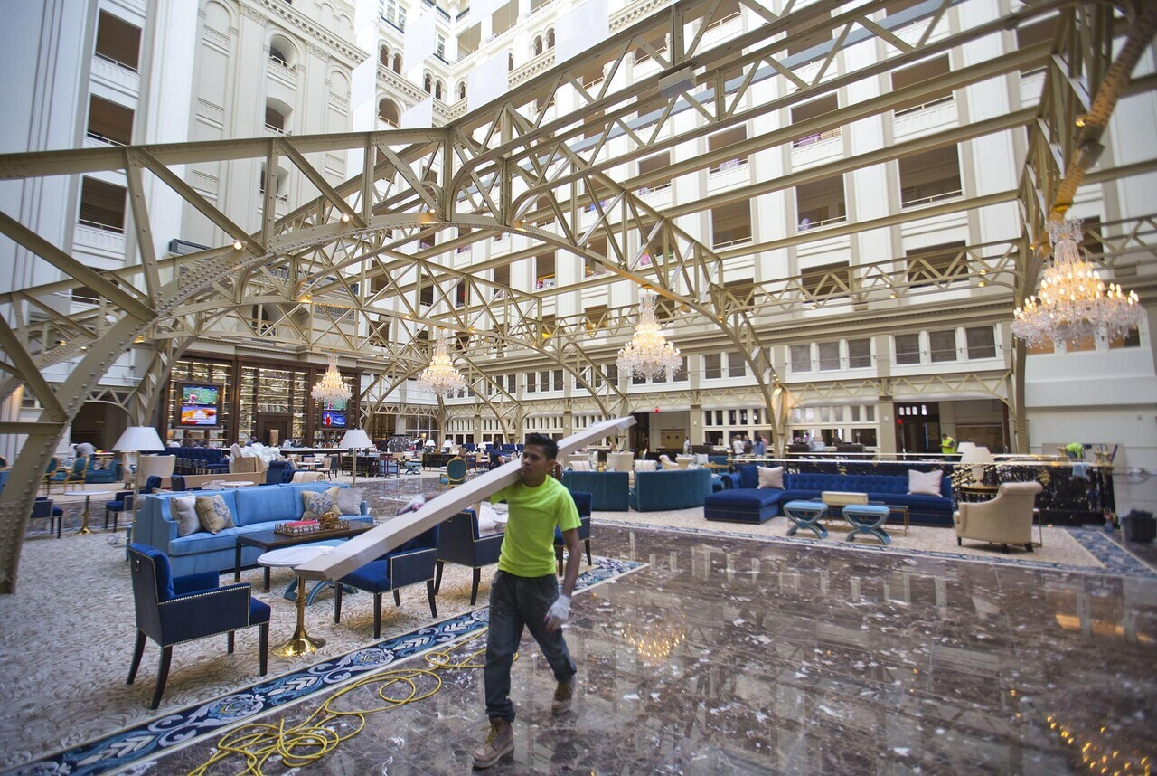 Workers continue work at the Trump International Hotel during the ' class=