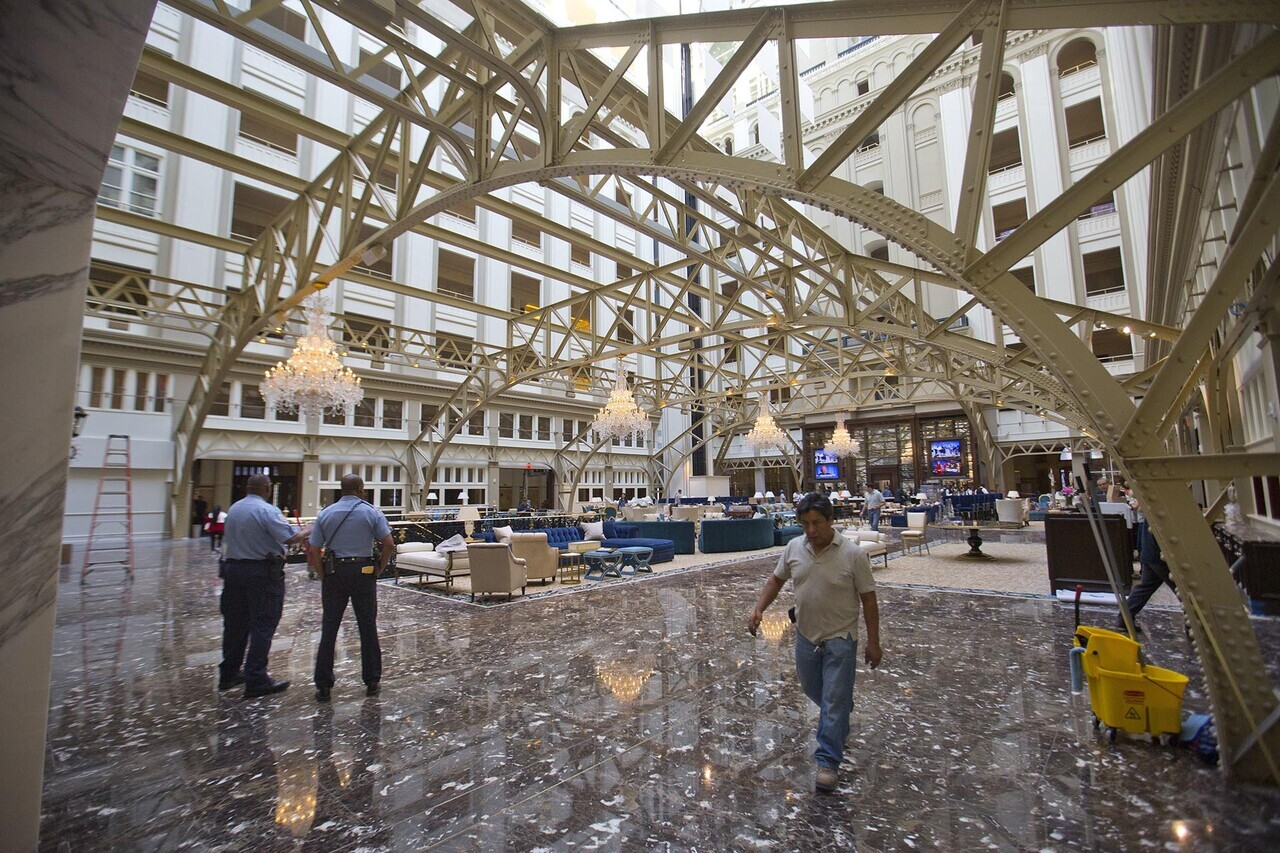 Main lobby of the Trump International Hotel in downtown Washington, Monday, Sept. 12, 2016. The luxury hotel Donald Trump has built in an iconic downtown Washington building is set to open. The Trump International Hotel will begin serving guests Monday. There won' class=